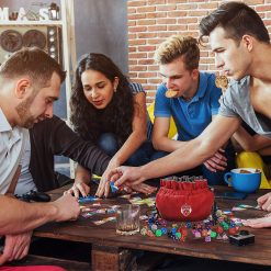 Five People Playing D&D using Cardkingpro Immense Dice Bags – Red - Pallet Table